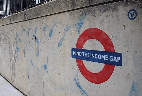 mind the income gap graffitti